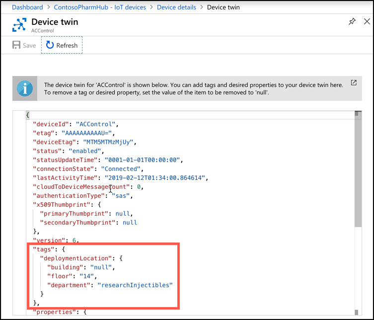 This screen shot shows the JSON representation of the device twin in IoT Hub. There are several tags set for the device, including one that is set to null in order to remove that tag.